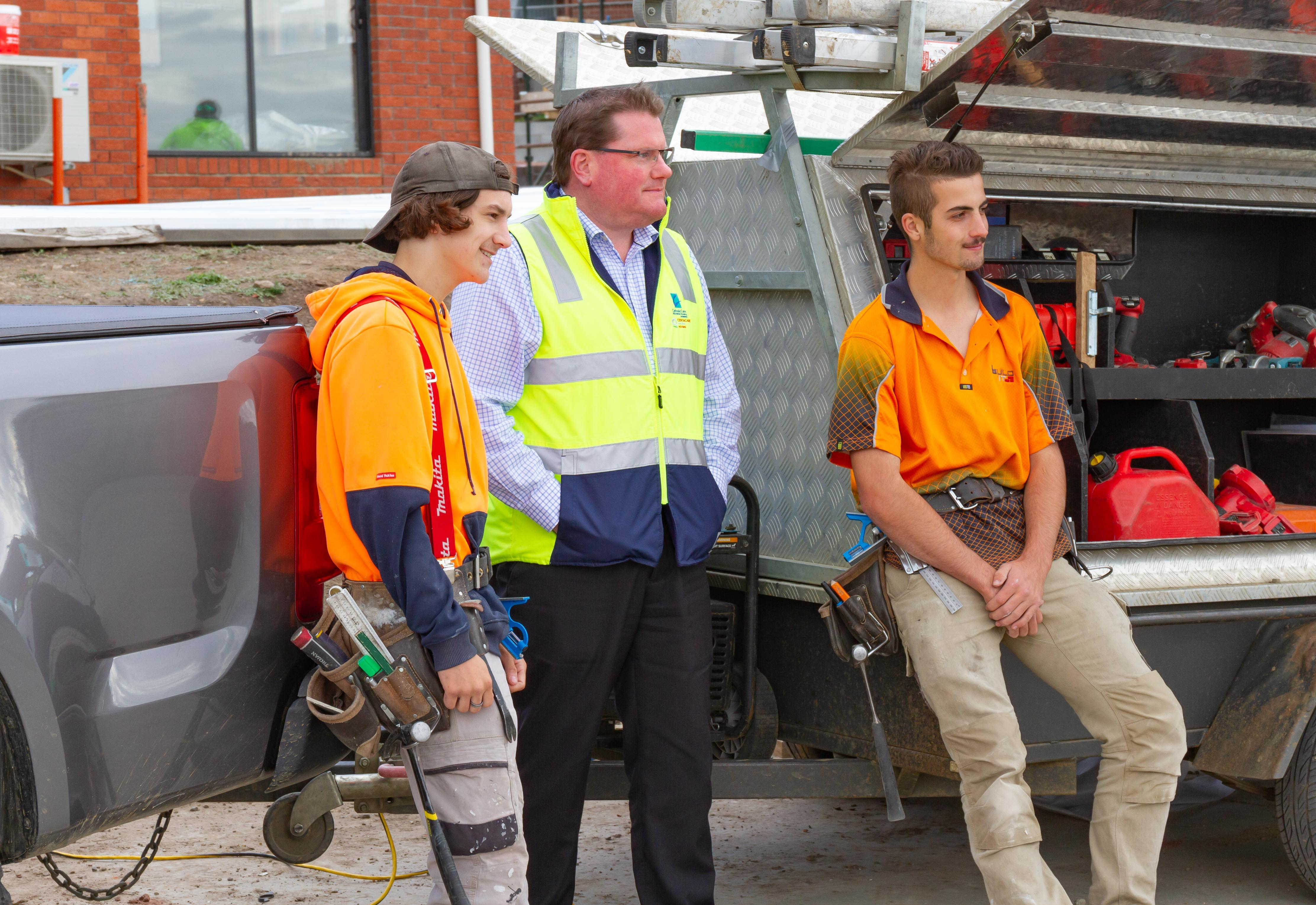 Apprentices Connor Baldwin (left), and Tom Dorsett (right), with Ben Wilson CEO Centacare Evolve Housing at a building site in Glenorchy.